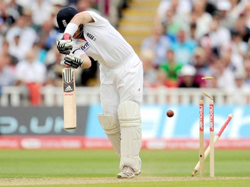 England's Ian Bell is bowled by Praveen Kumar for 34 during their third cricket Test match at the Edgbaston cricket ground in Birmingham.