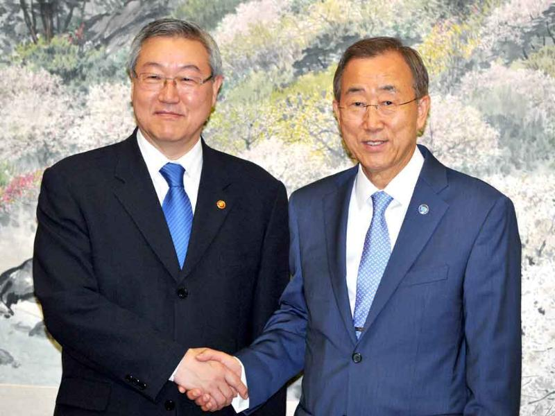 UN Secretary-General Ban Ki-moon (R) shakes hands with South Korea's Foreign Minister Kim Sung-hwan (L) before meeting in Seoul. Ban is on a six-day trip to South Korea after being elected to a second five-year term as UN chief in June.