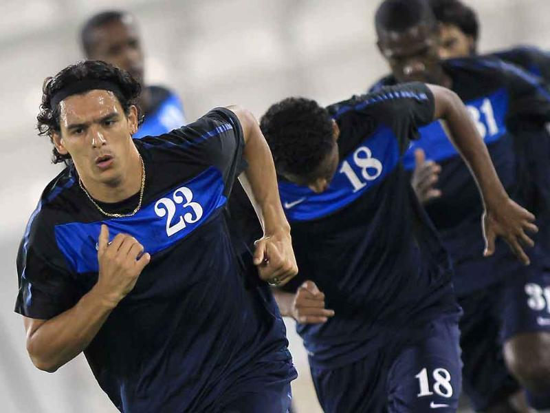 Qatar's national football team player Sebastian Soria (front) attends a training session in Doha.