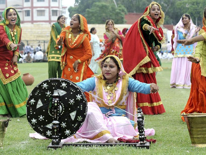 Schoolgirls perform the traditional gidda dance as they attend an Independence Day parade rehearsal at the Gandhi Ground in Amritsar.
