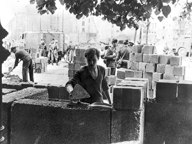 A file photo of a worker building parts of the wall between the eastern and western part of Berlin.