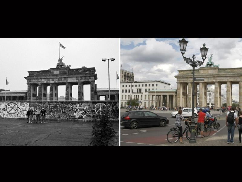A file combination photo shows tourists posing in front of the Berlin Wall at the Brandenburg gate in Berlin, June 6, 1989 (L) and a general view of the Brandenburg gate in Berlin, July 14, 2009