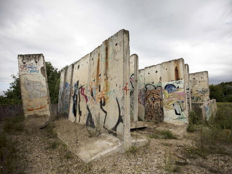Original parts of the Berlin Wall stand on an area of a construction material company in Teltow, Berlin. On August 13, Germany will witness the 50th anniversary of the construction of the Berlin Wall and commemorate the victims killed.