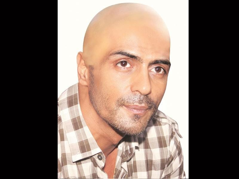 Actor Arjun Rampal has reportedly gone bald for his upcoming film Ra.One.