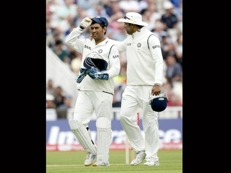 MS Dhoni and VVS Laxman leave the field for bad light on the third day of the third Test against England at the Edgbaston Cricket Ground, Birmingham.