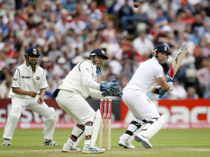 Matt Prior plays a shot as wicketkeeper MS Dhoni looks on during the third day of the third Test match at the Edgbaston Cricket Ground, Birmingham.