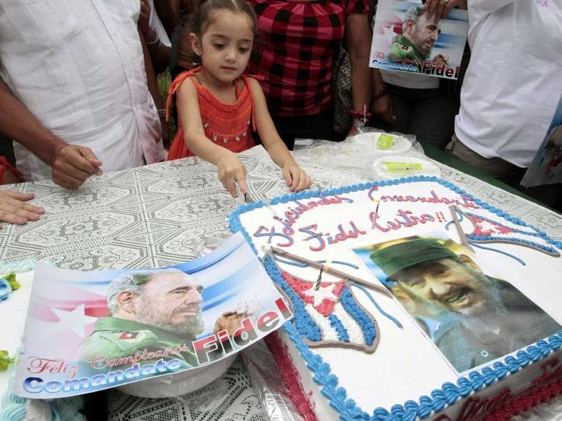 A child cuts a cake during birthday celebrations for former Cuban leader Fidel Castro by the Cuban Solidarity Brigade and his supporters in Managua. Castro turned 85 on his birthday today.