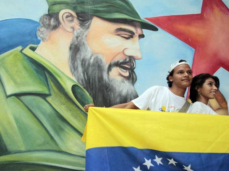 A couple poses with a picture of former Cuban leader Fidel Castro during birthday celebrations for Castro by the Cuban Solidarity Brigade and his supporters in Managua.