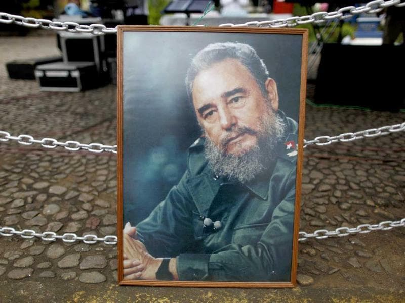 A portrait of Cuba's leader Fidel Castro hangs from a string of chains during a birthday celebration marking his 85th birthday, in Managua, Nicaragua. Supporters of the ruling Sandinista party, Cuban nationals and admirers gathered in Managua's Cuba Square to honor the elder Castro on the eve of his birthday.