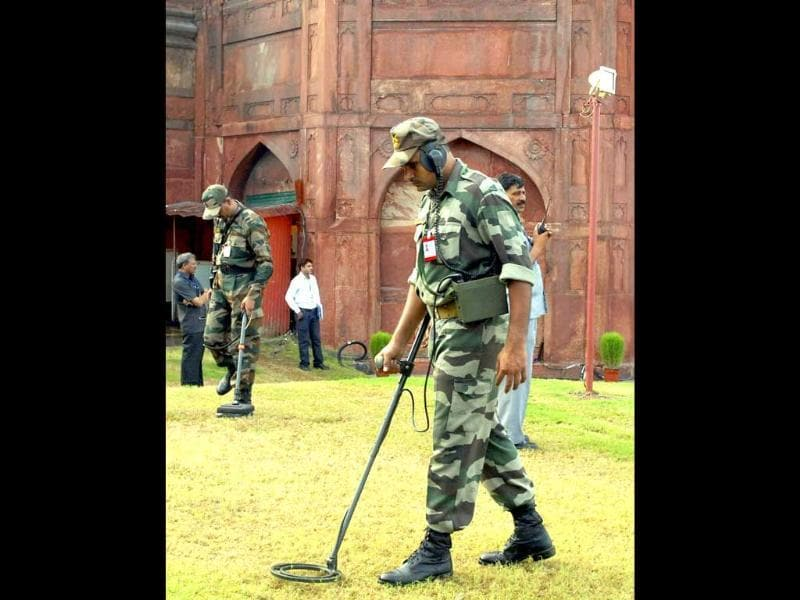 Indian army soldiers check around the Red Fort before a full dress rehearsal for Independence Day celebrations in New Delhi.