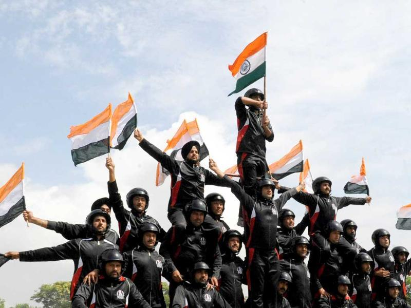 Members of the Indian police motorcyclist team preform during a full dress rehearsal for Indian Independence Day celebrations in Srinagar.