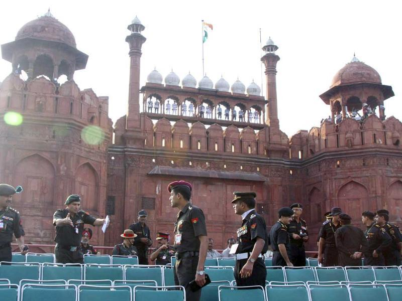 An Army officer gives instructions to soldiers during a rehearsal for Independence Day celebrations at the Red Fort in Delhi.
