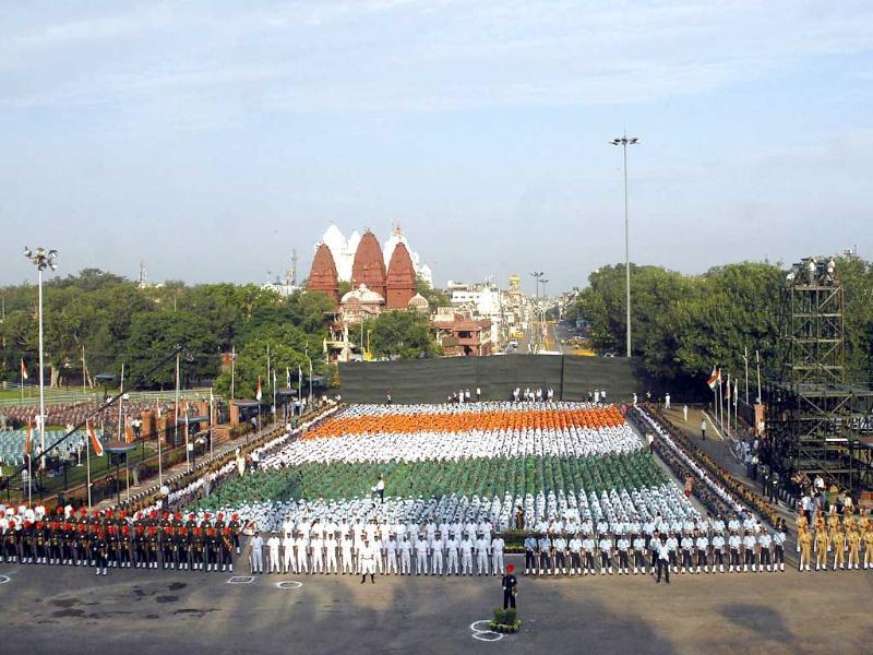 School children sit in formation as they depict Indian national flag during a full dress rehearsal for Independence Day celebrations at the Red Fort in New Delhi.