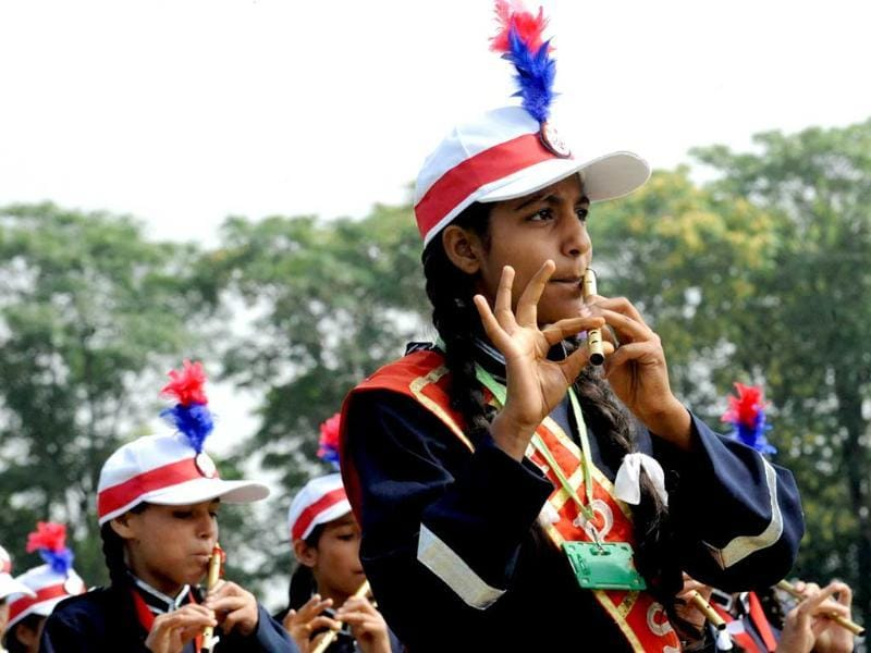 Students from an Indian police school play instruments during a full dress rehearsal for Independence Day celebrations in Srinagar.