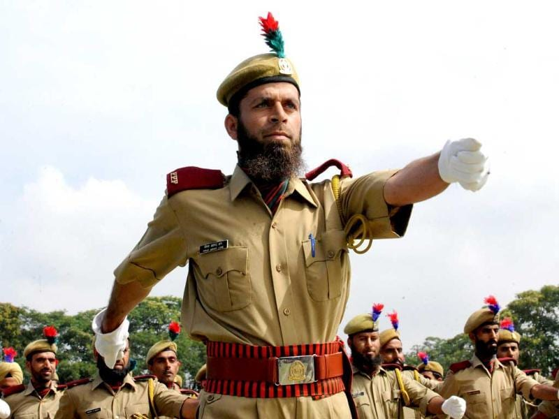Policeman march during a full dress rehearsal for Indian Independence Day Celebrations in Srinagar.