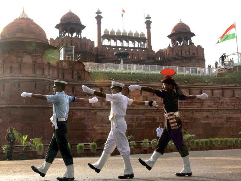 Services personnel march during full dress rehearsal of the 64th Independence Day function at Red Fort in New Delhi.