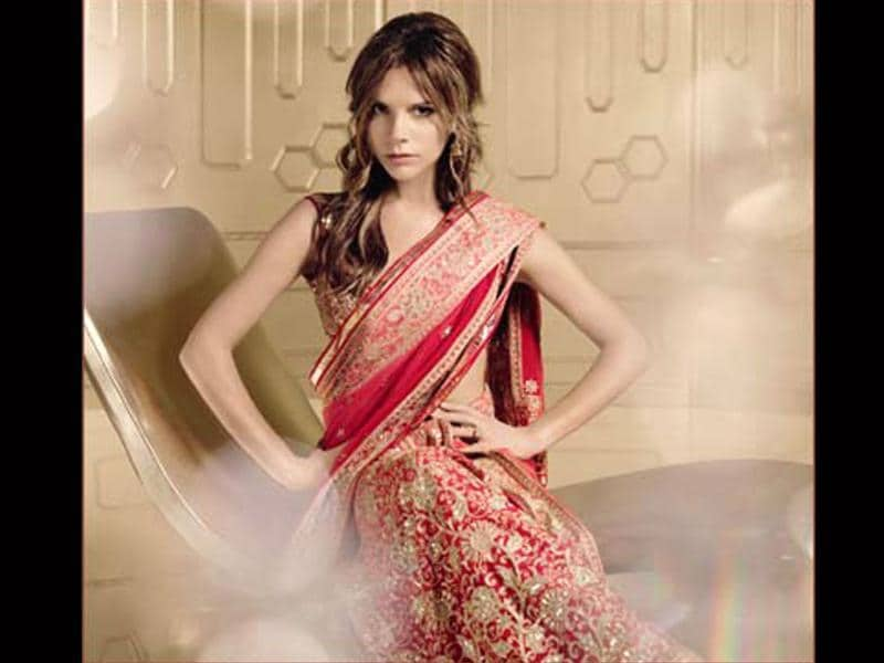 Victoria Beckham posed in a red bridal saree for Vogue magazine.
