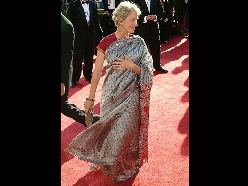 Helen Mirren turned up at the Emmy's draped in nine yards of silver and red.