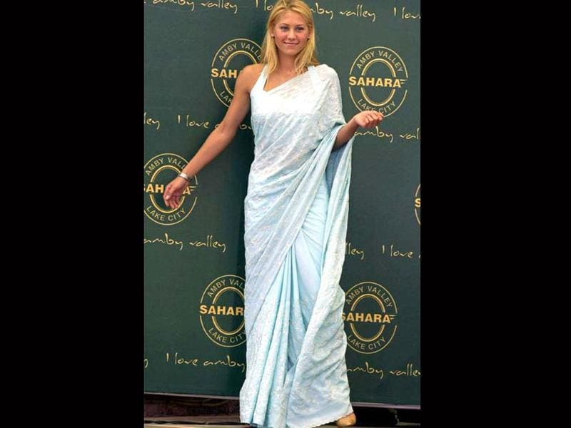 Anna Kournikova looks super cute in a baby blue saree with white embroidery at a tennis exhibition in Dubai.
