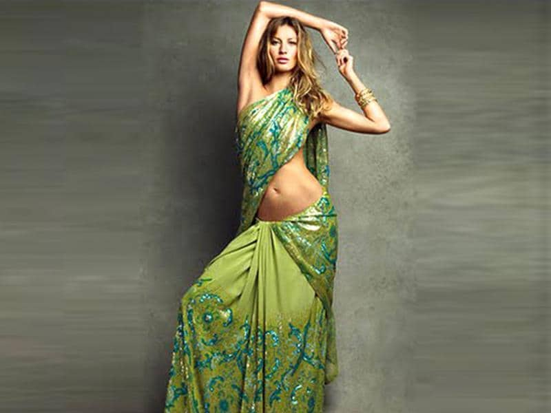 In the Septmber 2009 issue of Vogue India Brazilian model, Giselle Bundchen, sizzles in a sequined saree by Suneet Verma.