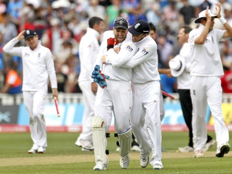 England's Graeme Swann, second right, and Matt Prior celebrate with team mates after beating India in the third Test match at the Edgbaston Cricket Ground, Birmingham.