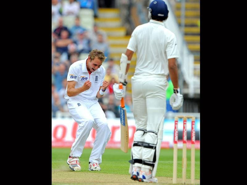 England's Stuart Broad (L) reacts after taking the wicket of India's Ishant Sharma (R) during the fourth day of the third Test match between England and India at the Edgbaston cricket ground in Birmingham.