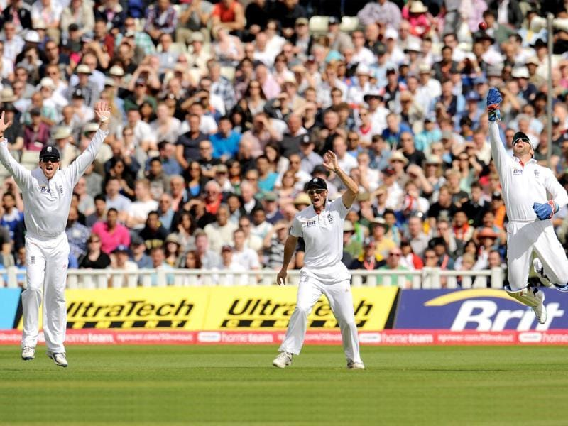 England's Graeme Swann (L), Andrew Strauss and Matt Prior (R) appeal and dismiss India's Rahul Dravid (not in picture) who was caught during the third cricket Test match at Edgbaston cricket ground in Birmingham.