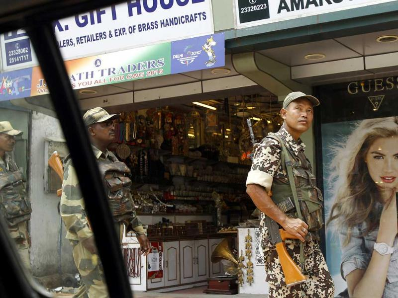 Paramilitary soldiers patrol a market as part of enhanced security ahead of Independence Day celebrations in New Delhi.