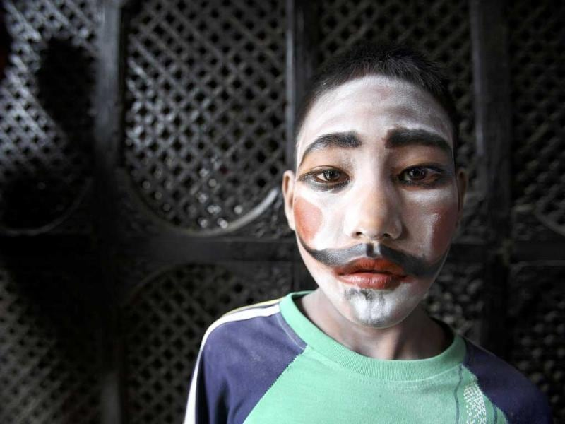 A boy dresses up as a holy man during the Gaijatra festival, also known as