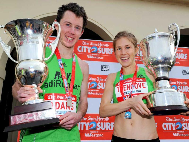 Five-time Australian world cross country champion Liam Adams (L) from Victoria and the fastest woman Jessica Trengove (R) from South Australia display their trophies after winning the 41st City2Surf race from Sydney to Bondi Beach. Liam beat 85,000 other competitors to win the 14 kilometre race -- the world's largest -- in 41 minutes and 11 seconds.