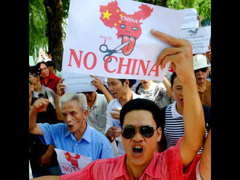 Vietnamese protesters shout anti-China slogans during a rally in the centre of Hanoi. About one hundred people took to Hanoi's streets to protest against Beijing's territorial ambitions in the South China Sea -- the 10th and latest in a string of anti-China rallies starting in June 2011. Both countries claim the potentially oil-rich Paracel and Spratly archipelagos in a long running dispute.