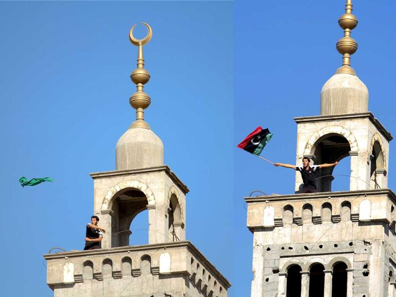 In this combo photograph, a Libyan rebel (L) removes and hurls the green Libyan national flag from the top of a mosque minaret, and then holds up the old Libyan flag (pre 1969 coup).