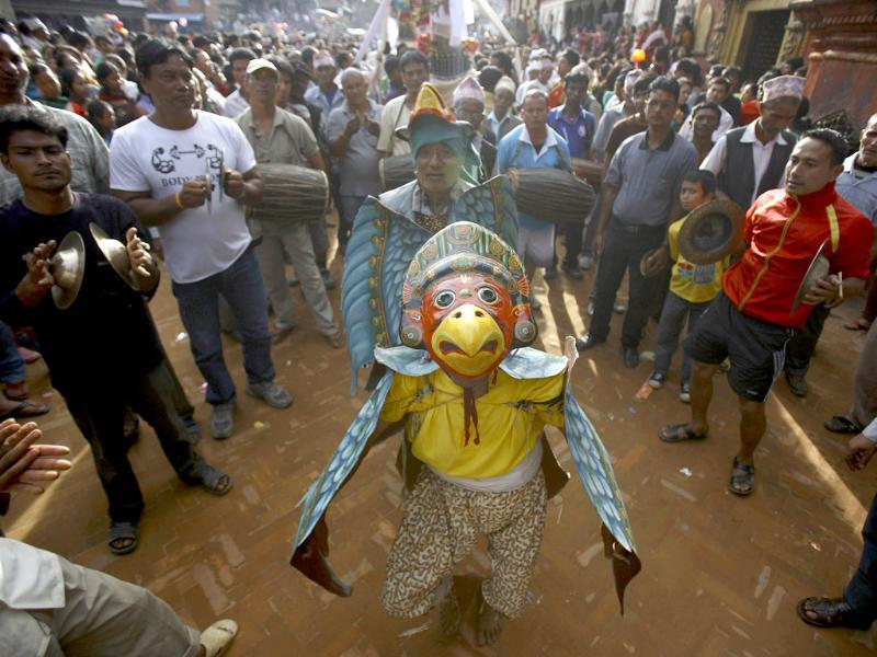 A man dressed as Lord Garuda participates in a parade during the Gaijatra festival, also known as