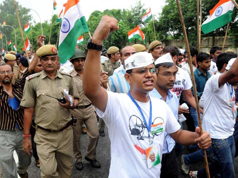 Supporters of social activist Anna Hazare shout slogans after his arrest in New Delhi.
