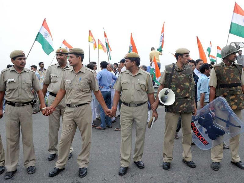 Police personnel cordon off supporters of social activist Anna Hazare after his arrest in New Delhi.
