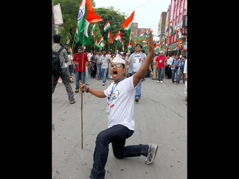 Supporters of Anna Hazare shout protest slogans after his arrest in New Delhi. Photo: Raj K Raj