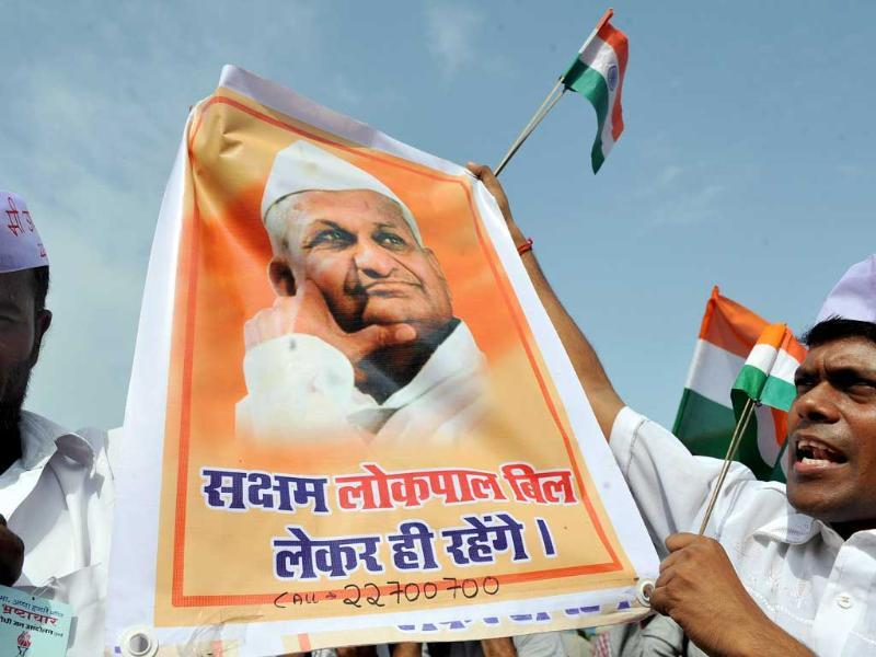 Followers of Anna Hazare hold a poster during a rally to show support for Hazare in Mumbai.