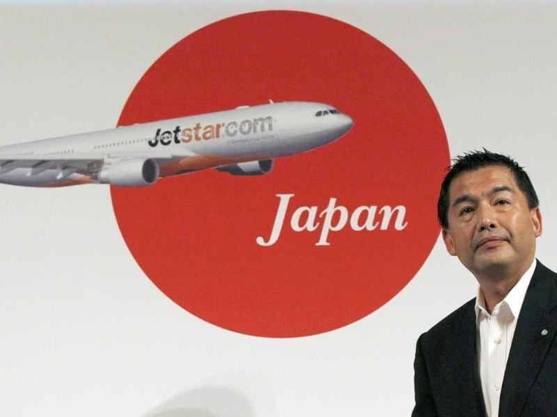 Japan Airlines President Masaru Onishi prepares for his speech during a joint news conference with Jetstar Group and Mitsubishi Corp. in Tokyo. Qantas low-cost subsidiary Jetstar will launch Japanese budget carrier Jetstar Japan jointly with Japan Airlines and Mitsubishi Corp.
