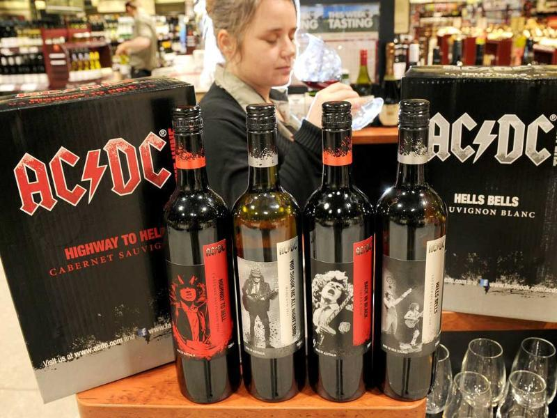 Tara Morgan of Dan Murphys liquor outlet inspects a glass of red wine, as Australian heavy metal band AC/DC hooks up with local winery Warburn Estate for a national release of 'AC/DC The Wine', in Melbourne. Available from August 18, 2011 and sourced from wine regions in the Barossa and Coonawarra, varieties include Back in Black Shiraz, Highway to Hell Cabernet Sauvignon and You Shook Me All Night Long Moscato.