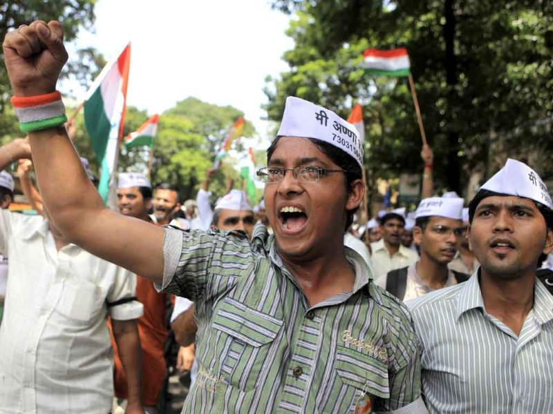 Supporters of rights activist Anna Hazare shout slogans during a rally in Mumbai.