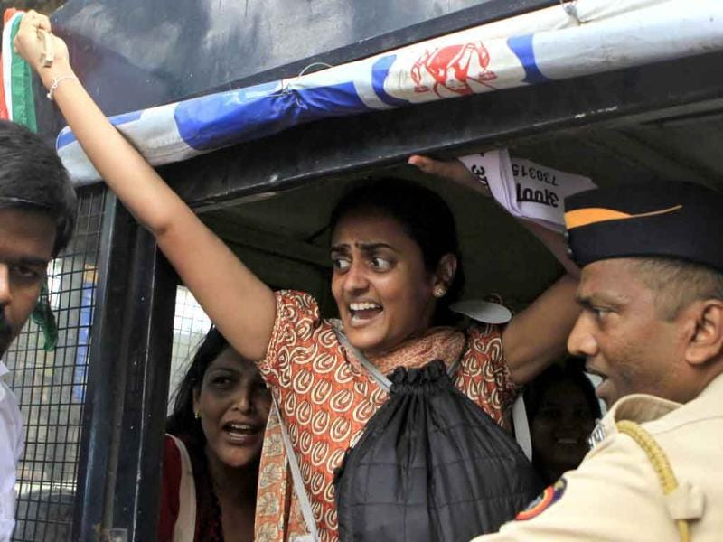 Supporters of rights activist Anna Hazare shout slogans as they are detained in a police van during a rally in support of Hazare's fight against corruption.