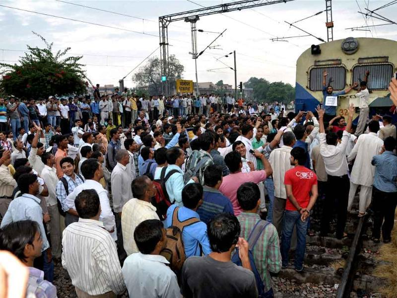 Students stop a train during a a protest in support of social activist Anna Hazare's movement against corruption at Sonipat.