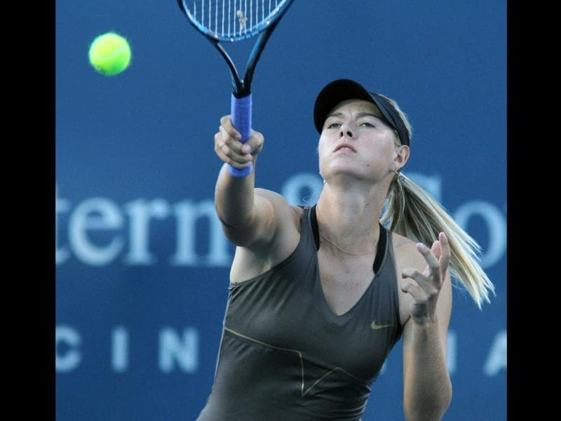 Maria Sharapova returns a volley to Anastasia Rodionova during a match at the Western & Southern Open in Mason, Ohio.