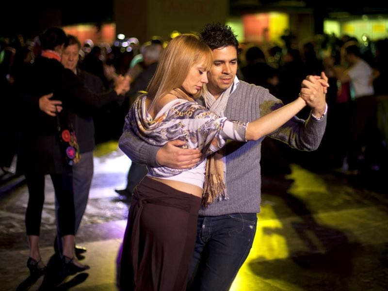 Couples dance during the inaugural night of the 2011 Tango World Championship in Buenos Aires, Argentina.