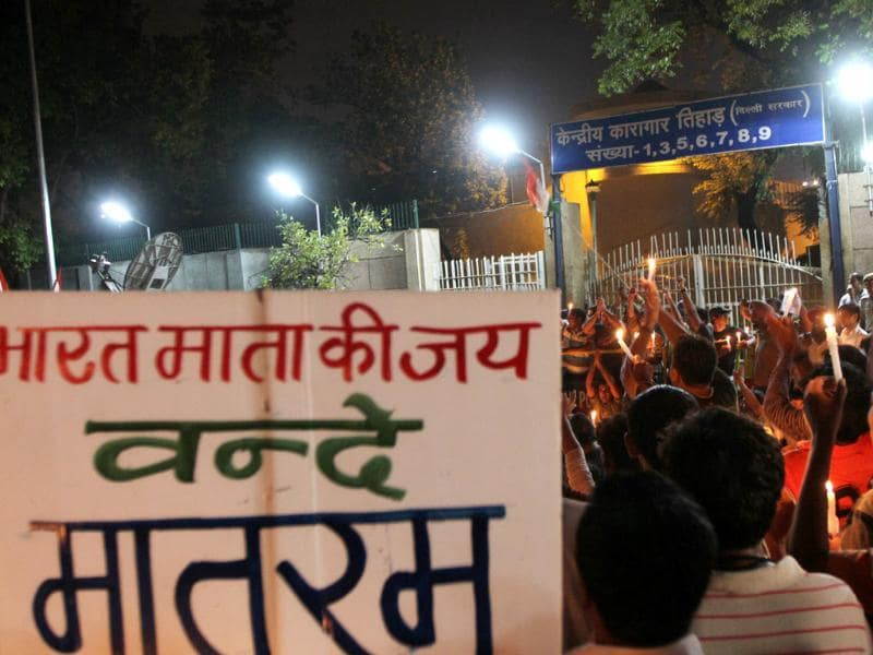 Anna Hazare supporters participate in the candle light vigil outside Tihar jail in New Delhi.