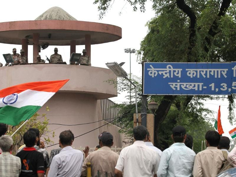Supporters of Anna Hazare protest outside Tihar jail in New Delhi.