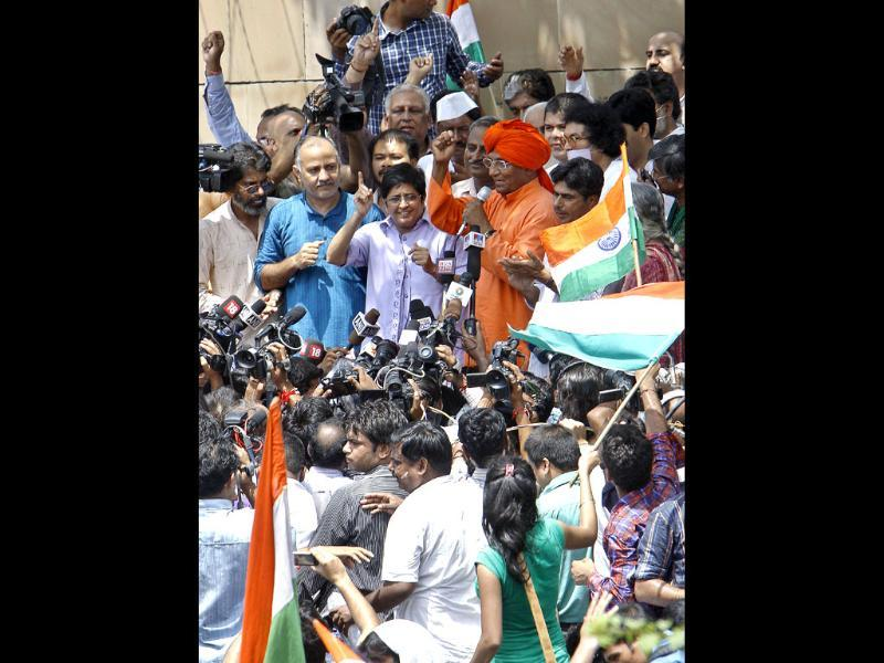 Members of Team Anna address the crowd gathered outside Tihar jail in New Delhi.