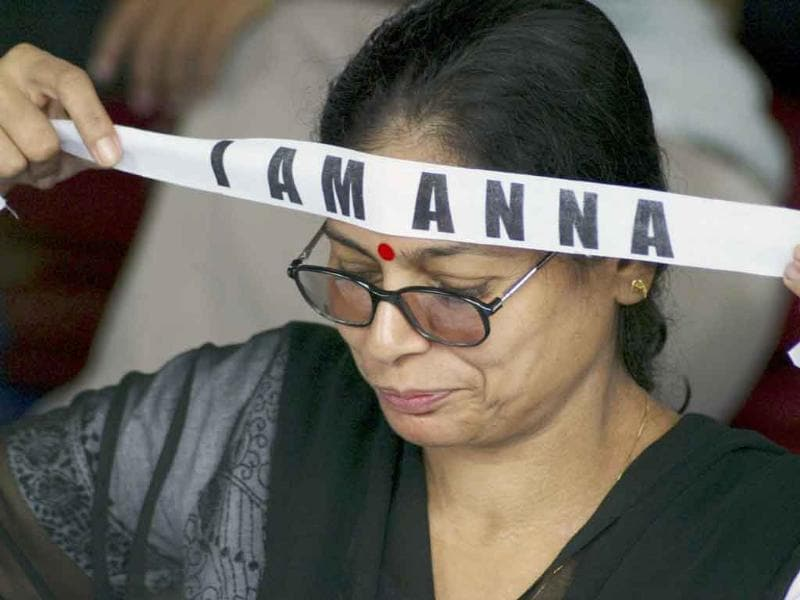An activist ties a headband in support of anti-corruption activist Anna Hazare during a rally in Bhubaneshwar.