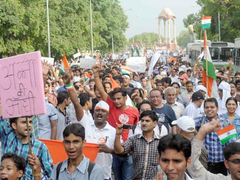 Thousands of people shout anti-government slogans as they march from the India Gate to Parliament street during a rally in support of social activist Anna Hazare in New Delhi.