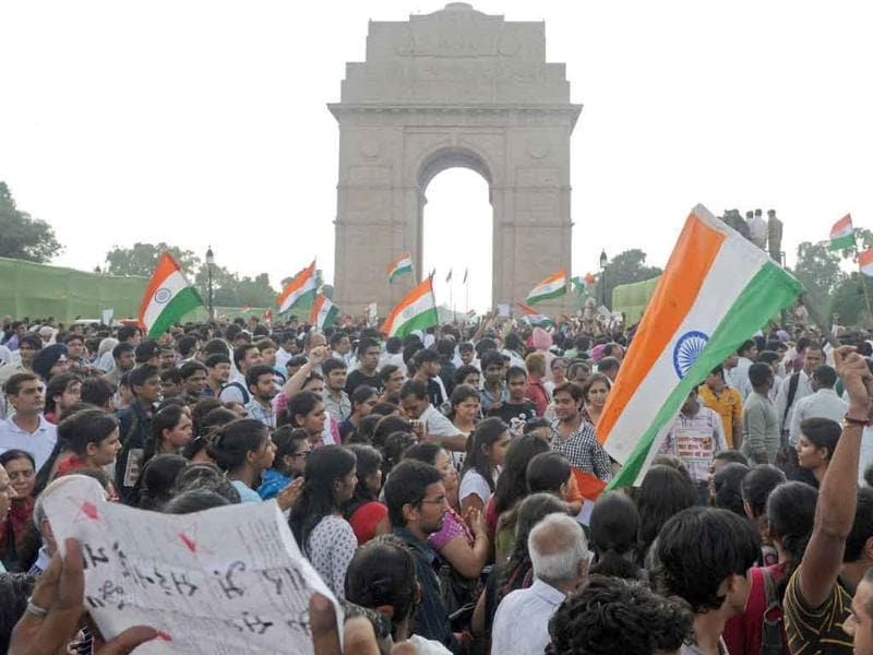Thousands of people shout anti-government slogans as they march from the India Gate monument to Parliament street during a rally in support of Indian social activist Anna Hazare in New Delhi.